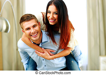Portrait of a young smiling couple having fun