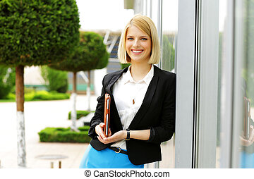Portrait of a young smiling woman outdoors