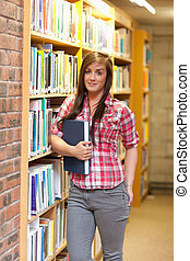 Portrait of a young student holding a book