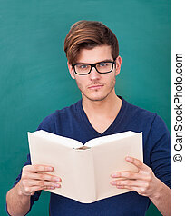 Young Student Holding Book