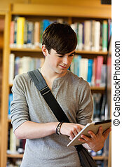 Portrait of a young student using a tablet computer