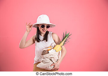 Portrait of a young stylish woman with an eco-fruit bag .
