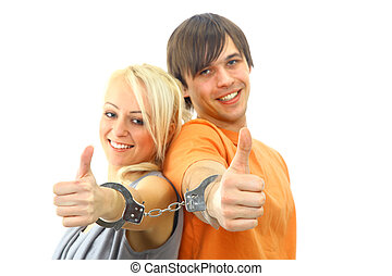 Portrait of a young teenage couple smiling against white background