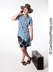 Portrait of a young tourist talking on the phone.