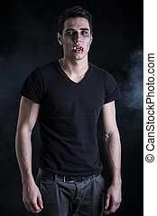 Portrait of a Young Vampire Man with Black T-Shirt