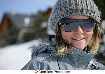 Portrait of a young woman at ski resort