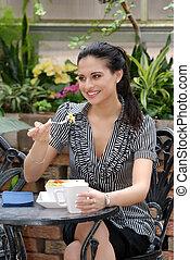 young woman eating salad