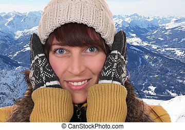 Portrait of a young woman freezing in the cold in winter in the