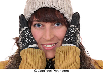 Portrait of a young woman freezing in the cold in winter