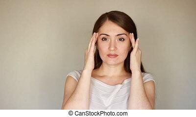 Portrait of a young woman. Headache, migraine, heartache,...
