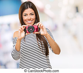 Portrait Of A Young Woman Holding Camera