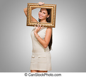 Portrait Of A Young Woman Holding Frame