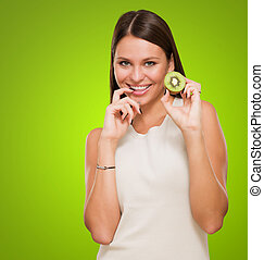 Portrait Of A Young Woman Holding Kiwi