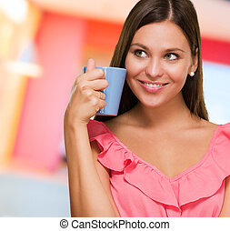 Portrait Of A Young Woman Holding Mug