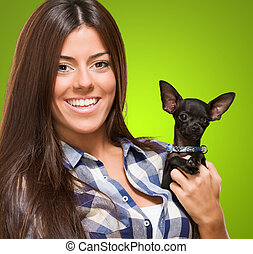 Portrait Of A Young Woman Holding Puppy