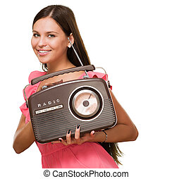 Portrait Of A Young Woman Holding Radio