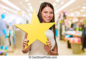 Portrait Of A Young Woman Holding Star