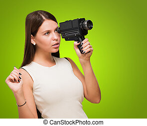 Portrait Of A Young Woman Holding Video Camera