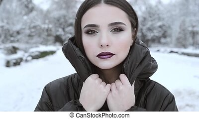 Portrait of a young woman in a winter jacket, close up