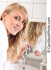 portrait of a young woman in bathroom