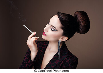 Portrait of a young woman in profile, smoking a cigarette