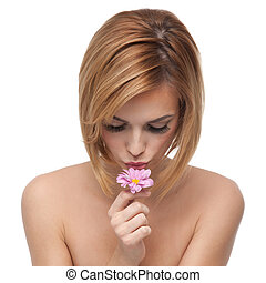 portrait of a young woman kissing a flower