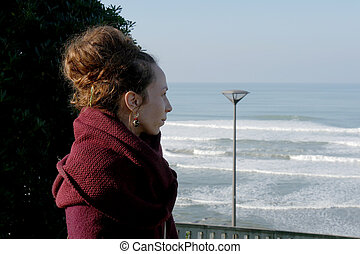 Portrait of a young woman looking at the sea