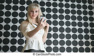 Portrait of a young woman making selfie photo