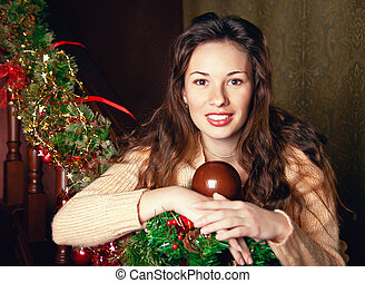 portrait of a young woman near the Christmas tree