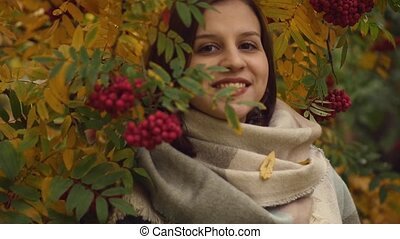 Portrait of a young woman on a background of yellow leaves...