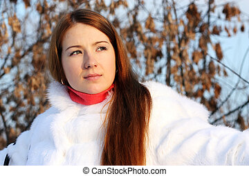 Portrait of a young woman on the background of a winter city