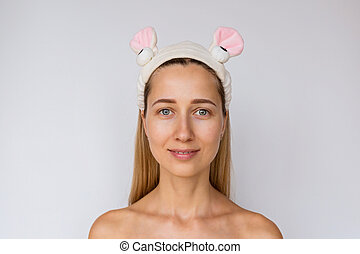 Portrait of a young woman on white background. Skin care and Spa treatments at home or beauty salon. Cosmetology concept
