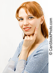 Portrait of a young woman on white background