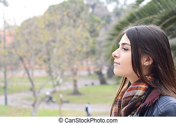 Portrait of a young woman outdoors.