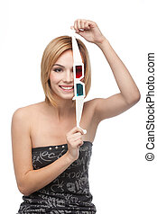 portrait of a young woman playing with 3d glasses