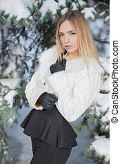 Portrait of a young woman posing in winter