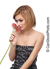 portrait of a young woman smelling a flower
