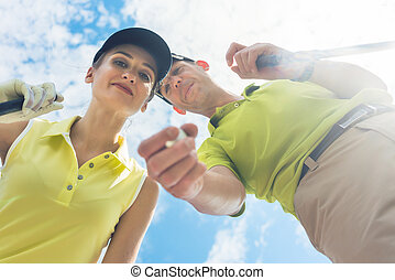 Portrait of a young woman smiling during professional golf game