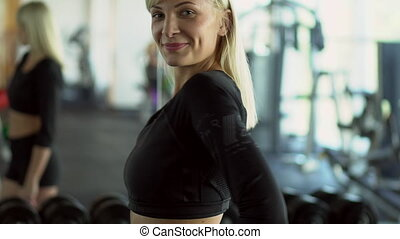 portrait of a young woman trainer in the gym - portrait of...
