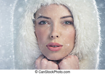 Portrait of a young woman wearing a fur cap