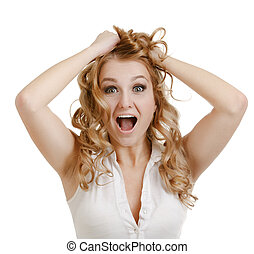 Portrait of a young woman with an expression of surprise and victory, isolated on a white background.