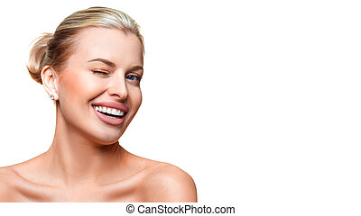 Portrait of a young woman with clear fresh skin winking. Isolated on white background.