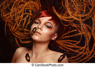 Portrait of a young woman with cockroaches on her face