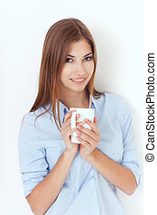 young woman with cup of tea or coffee