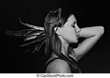 Portrait of a young woman with feathers