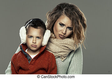 Portrait of a young woman with her son