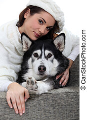Portrait of a young woman with husky