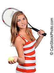 portrait of a young woman with racket