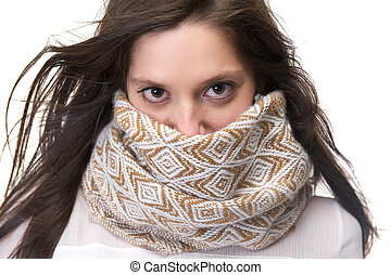 Portrait of a young woman with scarf covering face