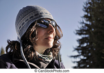 Portrait of a young woman with sunglasses at winter